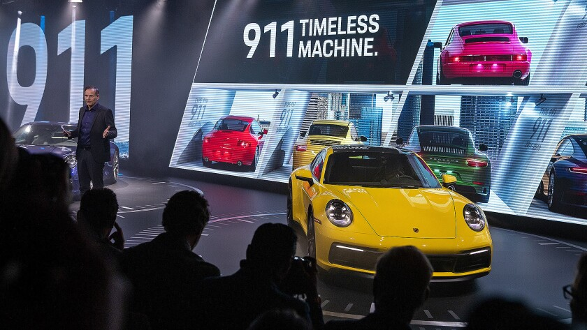 Porsche AG CEO Oliver Blume introduces the 2020 Porsche 911 models at the Los Angeles Auto Show.