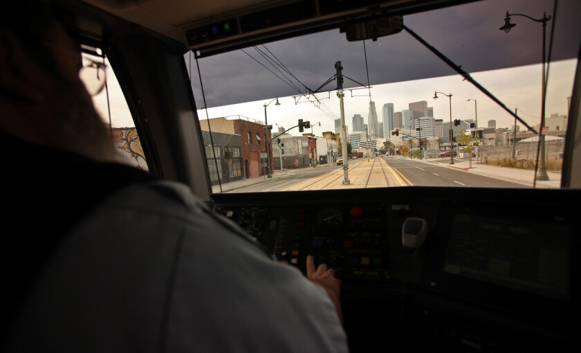 A Metro Gold Line operator guides a train heading west toward downtown Los Angeles.