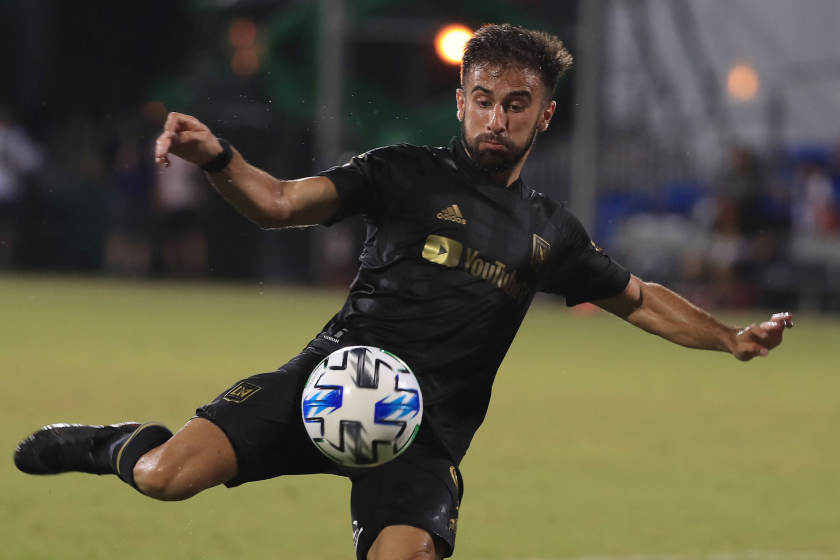 Forward Diego Rossi shoots the ball during a match between LAFC and Houston Dynamo.