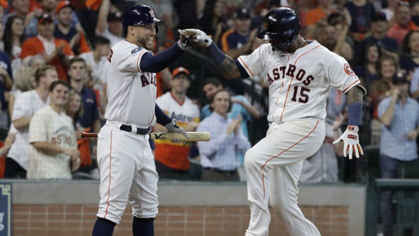 Martin Maldonado celebrates his solo home run against the Cleveland Indians with teammate George Springer, left, during Game 1 of an American League Division Series game.
