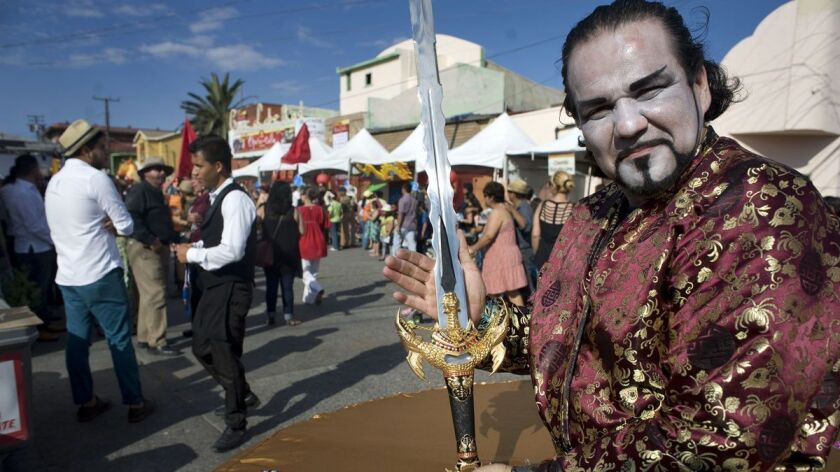 A performer in Giacomo Puccini's opera Turandot displays a prop sword at the 11th Opera en la Calle festival in 2016.