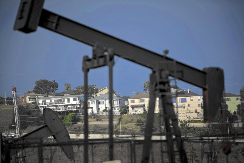 Homes in the Windsor Hills neighborhood of unincorporated L.A. County overlook the Inglewood Oil Field. A report found that 3.5 million people in L.A. County live within a mile of an oil well.