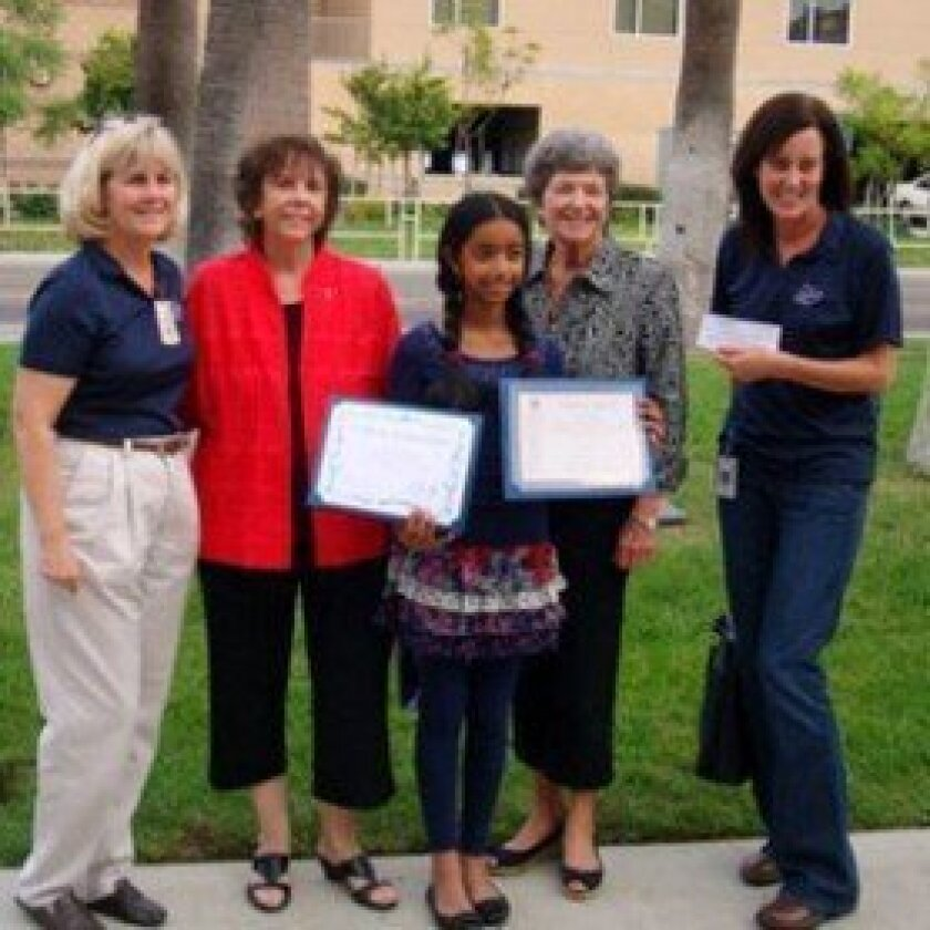 Sixth grader Anjali Haripriyan was recognized by the Del Mar-Solana Beach Optimists and Rady Children's Hospital for her contributions toward the childhood cancer fund. On Oct. 19 she was honored by (left to right) Carol D. Damon-Scherer, interim executive director at Rady, Optimists Audrey Eller and Susan Pfleeger and Dawn Ivy, Rady Children's community development officer.