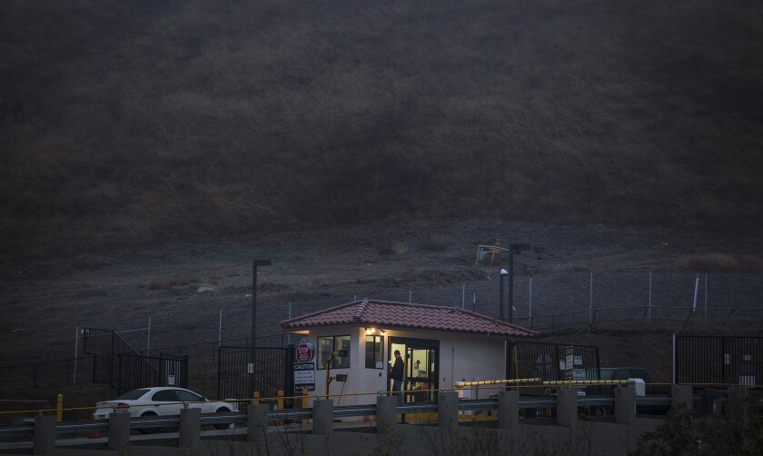 A security guard stands at the entry point to Southern California Gas Co.'s Aliso Canyon storage facility near Porter Ranch.