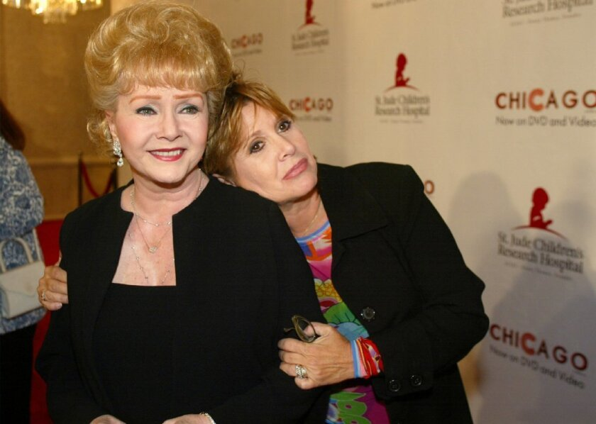 In this 2003 file photo, Debbie Reynolds and Carrie Fisher arrive at a fundraiser in Beverly Hills.