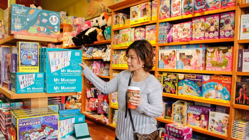 SAN DIEGO, CA December 24th, 2016 | Xay Sana does some last minute shopping at Geppetto's Toys in UT