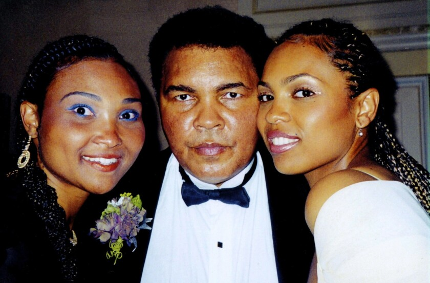 Maryum Ali, left, and her sister Hana with their father Muhammad Ali at the 2000 wedding of sister Laila Ali.