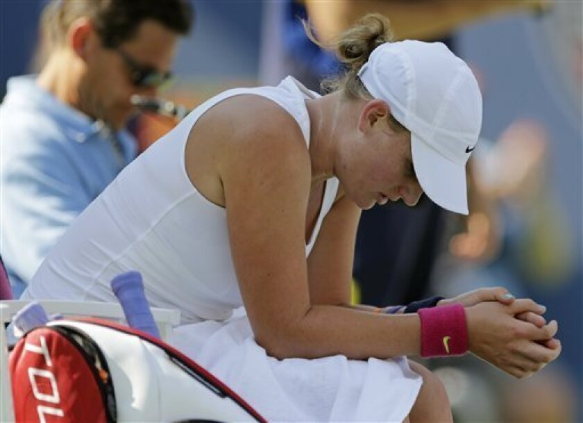 Mallory Burdette rests before resuming play against Maria Sharapova, of Russia,  in the third round of play at the 2012 US Open tennis tournament,  Friday, Aug. 31, 2012, in New York. (AP Photo/Mike Groll)
