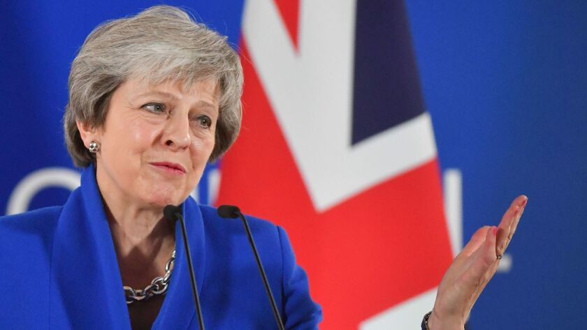 "British Prime Minister Theresa May speaks at a news conference after the European Council endorsed the draft ""Brexit"" withdrawal agreement on Nov. 25, 2018, in Brussels."