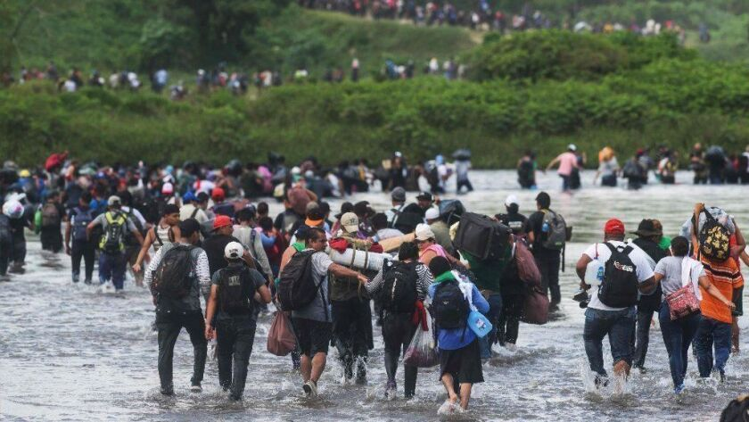A large group of Salvadoran migrants attempting to reach the United States crosses the Suchiate River into Mexico on Nov. 2.