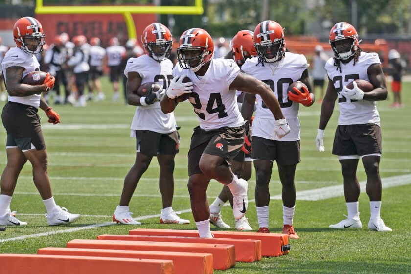 Cleveland Browns running back Nick Chubb (24) runs a drill during an NFL football practice, Saturday, July 31, 2021, in Berea, Ohio. (AP Photo/Tony Dejak)