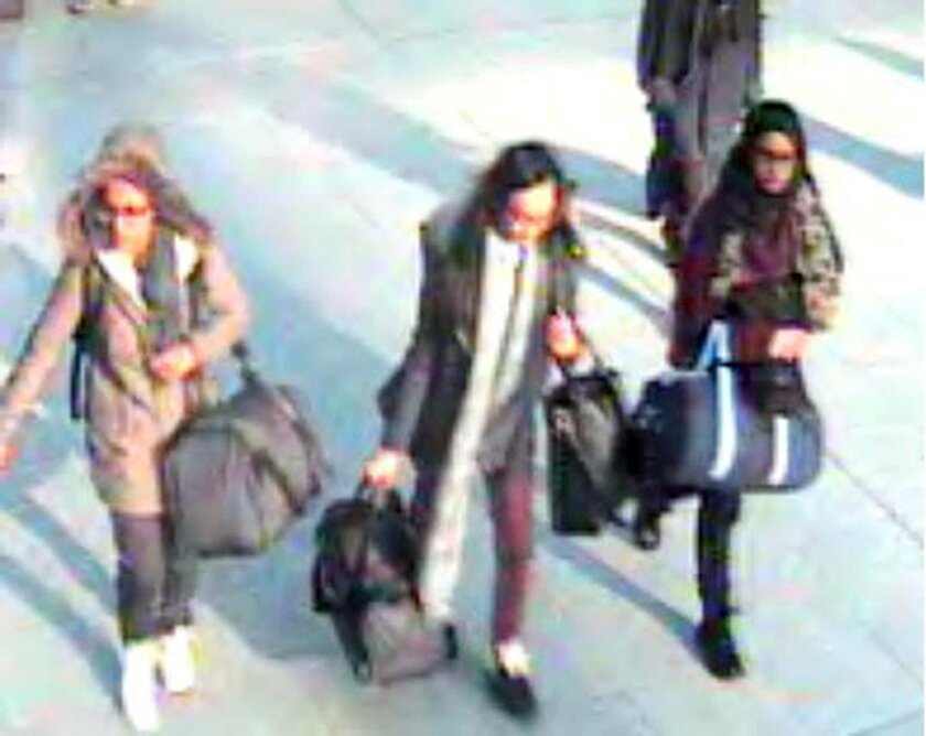 CORRECTING DATE TO MONDAY FEB. 23 - This is a still taken from CCTV issued by the Metropolitan Police in London on Monday Feb. 23, 2015, of 15-year-old Amira Abase, left, Kadiza Sultana,16, centre, and Shamima Begum, 15, going through Gatwick airport, south of London, before they caught their flight to Turkey on Tuesday Feb 17, 2015. The three teenage girls left the country in a suspected bid to travel to Syria to join the Islamic State extremist group. (AP Photo/Metropolitan Police) NO ARCHIVE