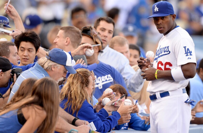 The popularity of the outfielder Yasiel Puig and the Dodgers has led to an increased demand for season-ticket renewal and requests.