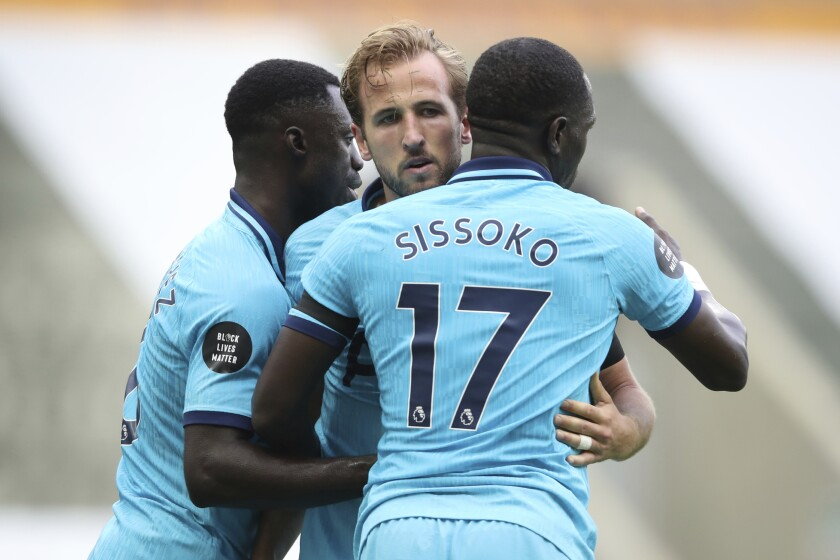 Tottenham's Harry Kane, center, celebrates after scoring his side's third goal during the English Premier League soccer match between Newcastle United and Tottenham Hotspur at St. James' Park in Newcastle, England, Wednesday, July 15, 2020. (Owen Humphreys/Pool via AP)