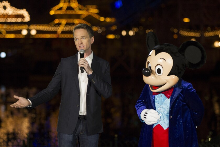 """Actor Neil Patrick Harris and Mickey Mouse introduce Disney California Adventure's new """"World of Color: Celebrate!"""" to the media for Disneyland's 60th anniversary celebration."""