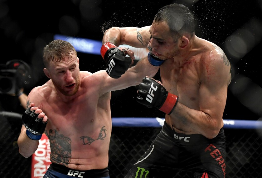 Justin Gaethje, left, hits Tony Ferguson at UFC 249 on May 9, 2020, in Jacksonville, Fla.