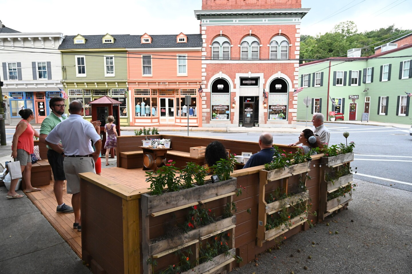 People gather to celebrate the opening of the new parklet, at the intersection of Main Street and Sandosky Road, in Sykesville on August 20.