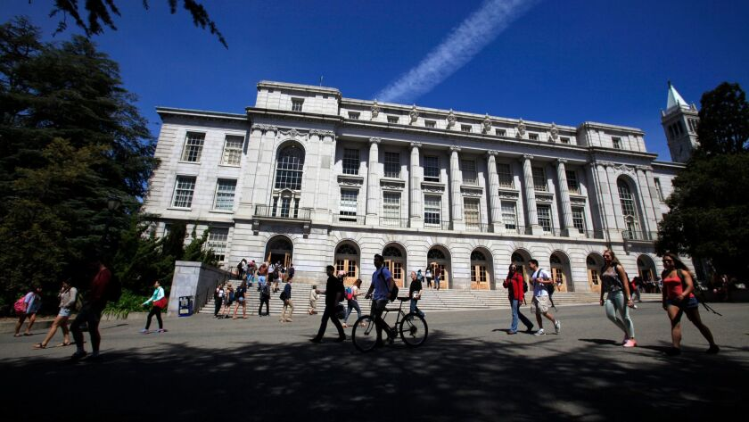 Students stroll past Wheeler Hall at University of California, Berkeley in April of 2014.