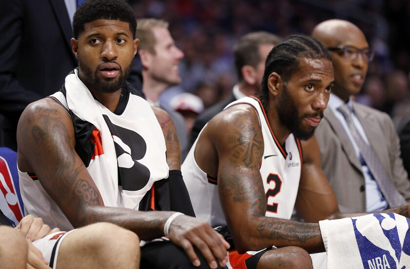 Clippers stars Paul George, left, and Kawhi Leonard didn't have to do all the work in the team's 117-97 victory over the Portland Trail Blazers at Staples Center on Tuesday.
