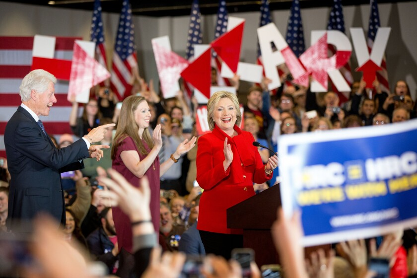 Democratic presidential candidate Hillary Clinton, accompanied by former President Bill Clinton and their daughter Chelsea Clinton, arrives onstage at her caucus night rally at Drake University in Des Moines, Iowa.