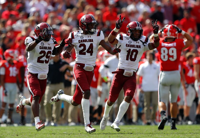 South Carolina's Israel Mukuamu (24) reacts after his second interception of the game against Georgia in the second half of their 20-17 double-overtime win on Saturday in Athens, Ga.