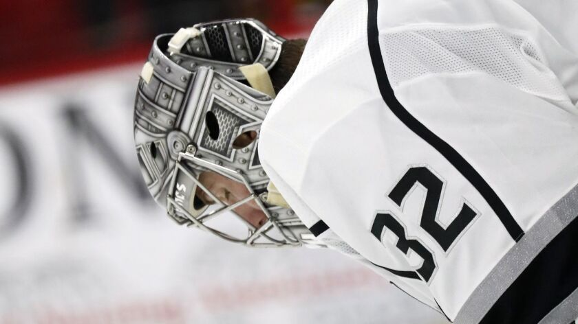 Los Angeles Kings' Jonathan Quick (32) hangs his head after giving up a goal to the Carolina Hurrica