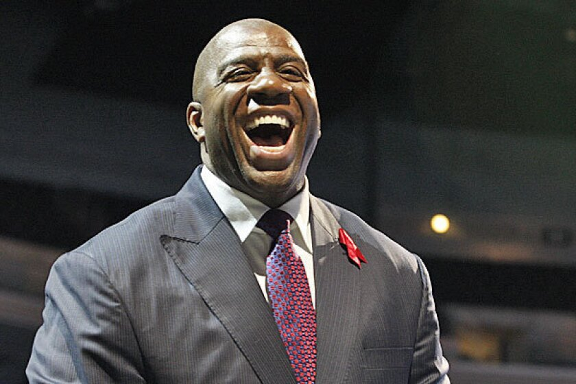 The group, headed by the Lakers legend Magic Johnson who is known for community involvement, agrees to pay $2 billion for the team. Frank McCourt keeps a small land take.