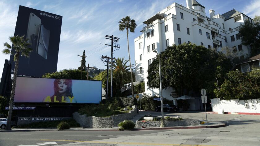 "The singer from ""A Star Is Born,"" as played by Lady Gaga, is on a massive billboard in front of the Chateau Marmont. Songs from the film are nominated for a Grammy Award."
