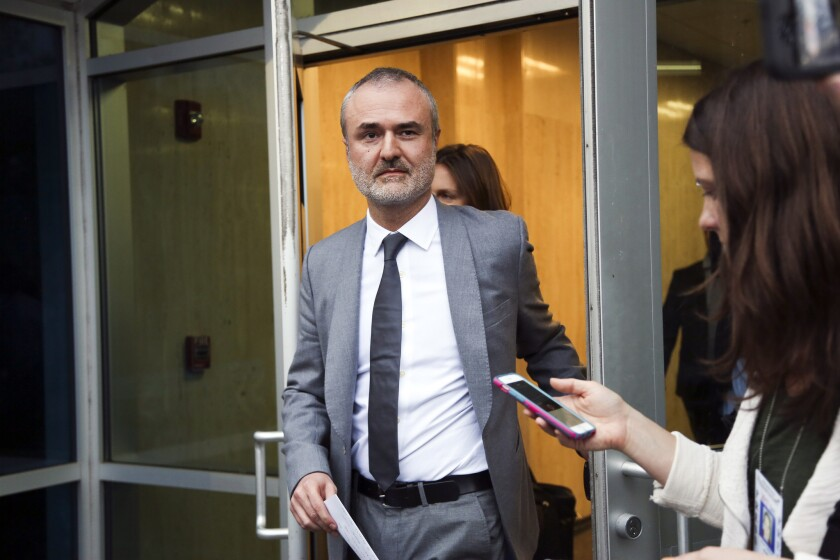 Gawker founder Nick Denton walks out of the courthouse on March 18.