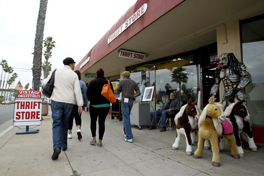 Pedestrians walk past th Vintage Collectables thrift store on South Coast Highway in Oceanside on Wednesday.
