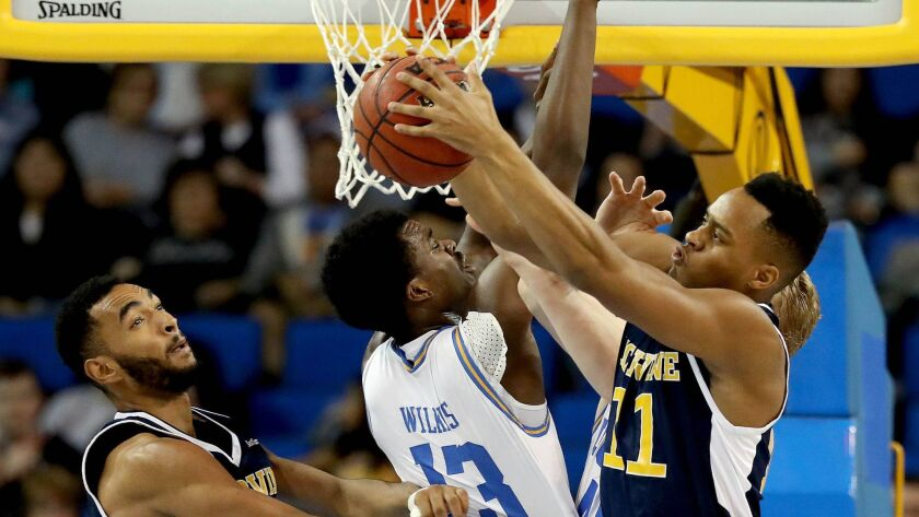 LOS ANGELES, CALIF. -- SUNDAY, NOVEMBER 26, 2017: UCLA Bruins guard Kris Wilkes (13) fights for a re