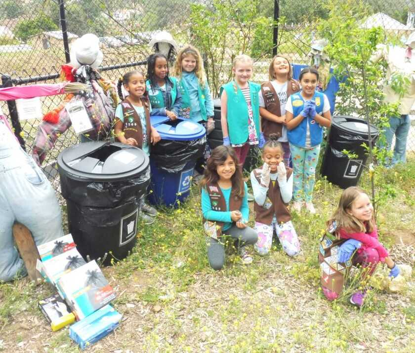 """Vista Girl Scout Troop 1569 celebrated Earth Day by donating new trash and recycle bins to Alta Vista Botanical Gardens, where the girls earned outdoor-related badges with Nancy B Jones, aka """"Farmer Jones."""" The troop used some of the money from their cookie sales to buy the bins, trash bags and new signs to help visitors dispose of their trash, recyclables and compost items into the proper cans. The girls decided on the project after learning from Farmer Jones that sometimes garden visitors left trash behind because they could not find trash cans. The troop tied this idea to their Global Action Award Take-Action Project, touching on United Nations Goal #15: Life on Land, promoting sustainable use in ecosystems. Troop leaders are Jessica Frey, Andillon Hackney and Sophie Tewolde. Visit altavistabotanicalgardens.org."""
