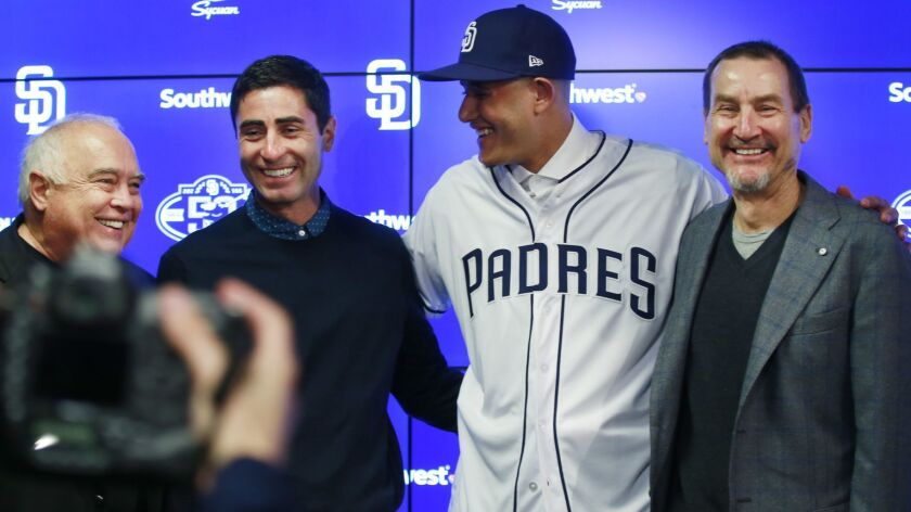 From left, Padres Executive Chairman Ron Fowler, GM A.J. Preller, Manny Machado and General Partner Peter Seidler.