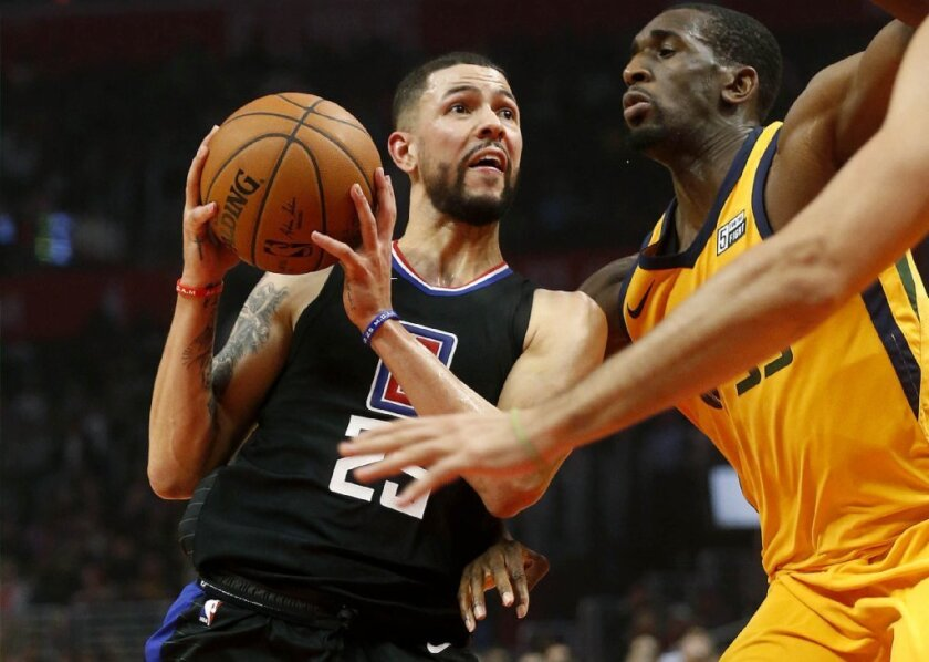 Clippers guard Austin Rivers, left, drives against Jazz center Ekpe Udoh during the first half of a game Nov. 30 at Staples Center.