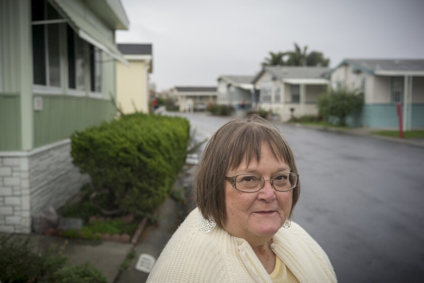 Judy Pavlick outside her mobile home in the Plaza del Rey mobile home park. She is leading a rent control campaign in Sunnyvale, Calif.