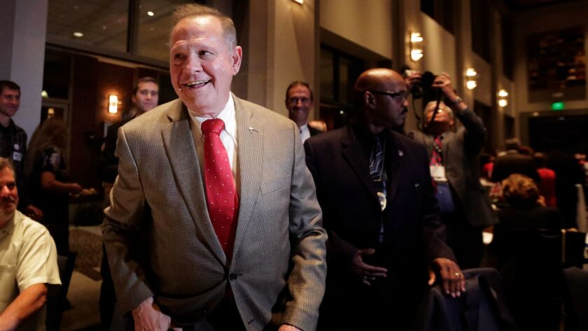 U.S. Senate candidate Roy Moore greets supporters before his election party in Montgomery, Ala. on Sept. 26.