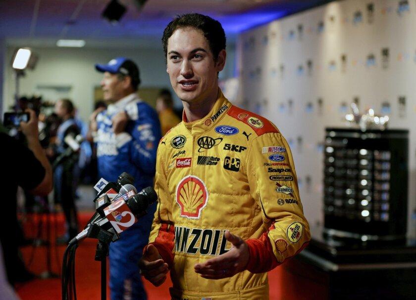 Joey Logano talks with reporters at NASCAR media day at Daytona International Speedway, Tuesday, Feb. 16, 2016, in Daytona Beach, Fla. (AP Photo/John Raoux)