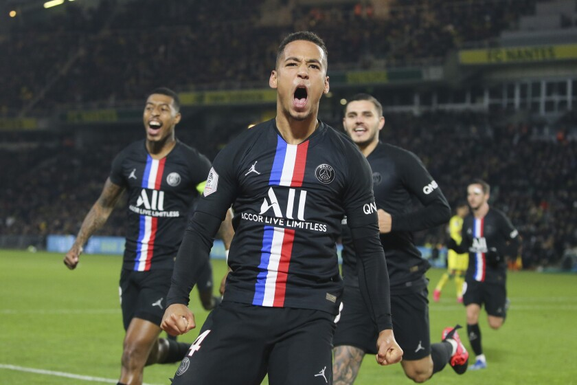 PSG's Thilo Kehrer, right, celebrates scoring his side's second goal during the League One soccer match between Nantes and Paris-Saint-Germain, in Nantes, western France, Tuesday, Feb. 4, 2020. (AP Photo/David Vincent)