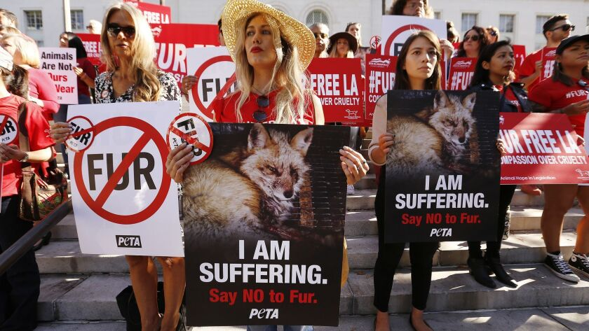 LOS ANGELES, CA ? SEPTEMBER 18, 2018: Margo Paine, middle, joins dozens of animals rights activists