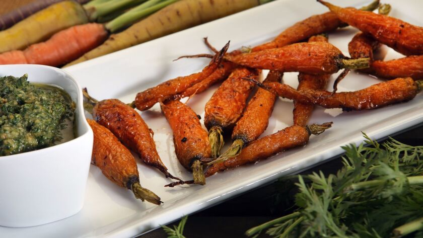 Roasted carrots with carrot top pesto.