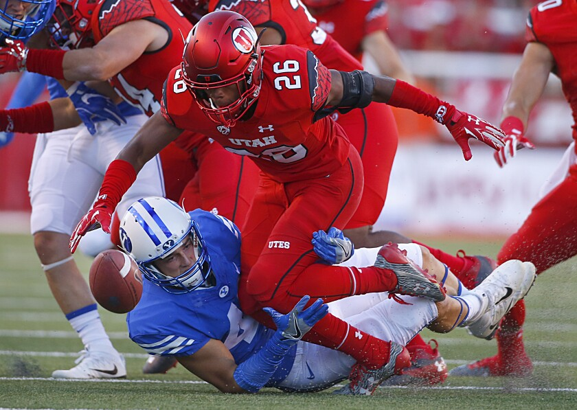 Utah product Terrell Burgess (26) pursues a loose ball against Brigham Young.