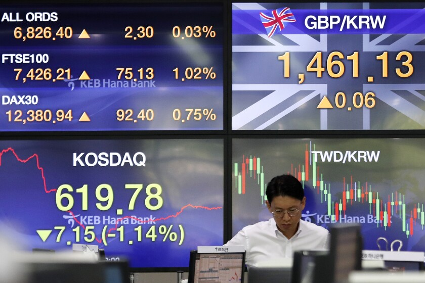 A currency trader watches monitors at the foreign exchange dealing room of the KEB Hana Bank headquarters in Seoul, South Korea, Monday, Sept. 30, 2019. Shares were mixed in a narrow range in Asia on Monday, with markets in China heading into a national holiday. (AP Photo/Ahn Young-joon)