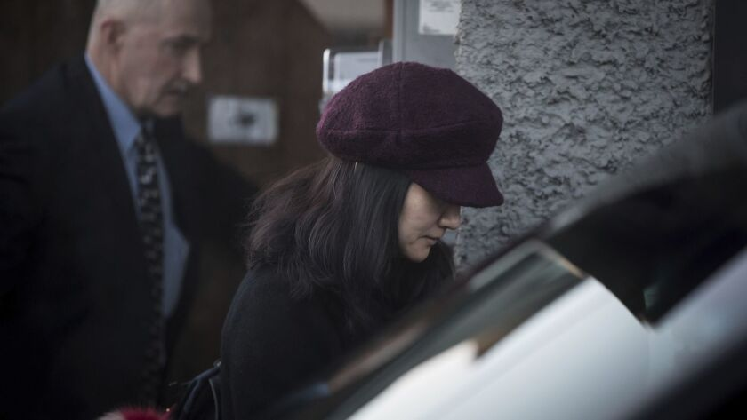Huawei Chief Financial Officer Meng Wanzhou, who is out on bail and remains under partial house arrest after she was detained Dec. 1 at the behest of American authorities, leaves her home to attend a court appearance regarding her bail conditions, in Vancouver, Canada.