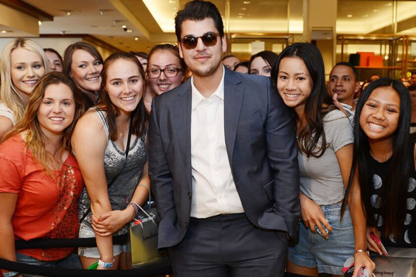 Rob Kardashian poses with fans during his new Arthur George by Rob Kardashian sock collection unveiling at Neiman Marcus last month in Las Vegas.