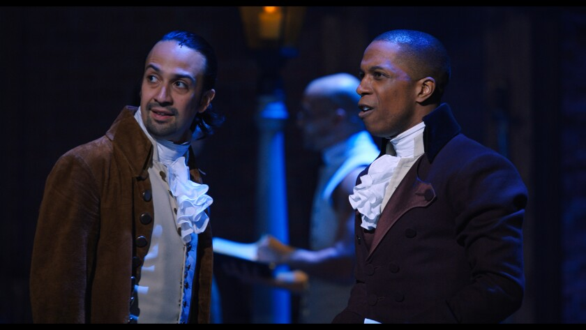 "Lin-Manuel Miranda and Leslie Odom Jr. in the filmed version of the Broadway production of ""Hamilton."""