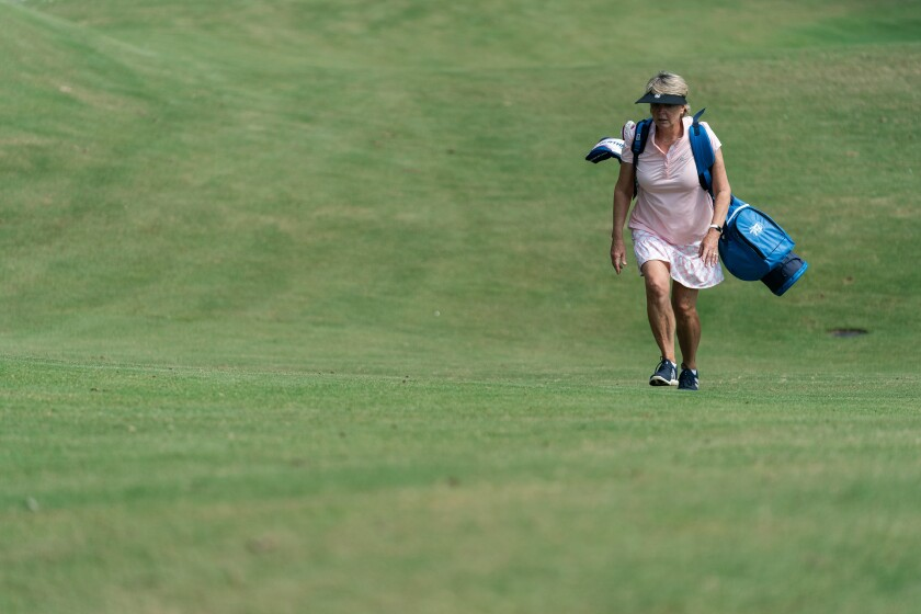 Winky Fowler used to ride in a cart. Now she enjoys walking and carrying her bag at Bobby Jones Golf Course in Atlanta.