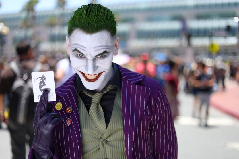 Costumed Comic-Con attendees like Jordan Quinzon of Upland, dressed as the Joker at last year's San Diego gathering, won't be seen this year, but organizers are putting together an at-home experience for the Con that could include panel discussions and a number of other online offerings of streamed content.
