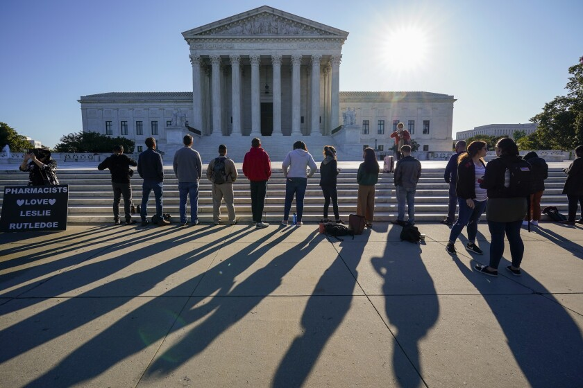"Anti-abortion activists with ""Bound 4 Life"" demonstrate at the Supreme Court in Washington, Monday, Oct. 5, 2020, as the justices begin a new term without the late Justice Ruth Bader Ginsburg. (AP Photo/J. Scott Applewhite)"