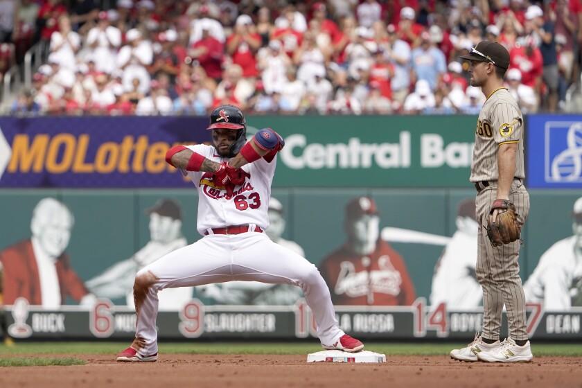 The Cardinals' Edmundo Sosa celebrates as San Diego Padres second baseman Adam Frazier looks on