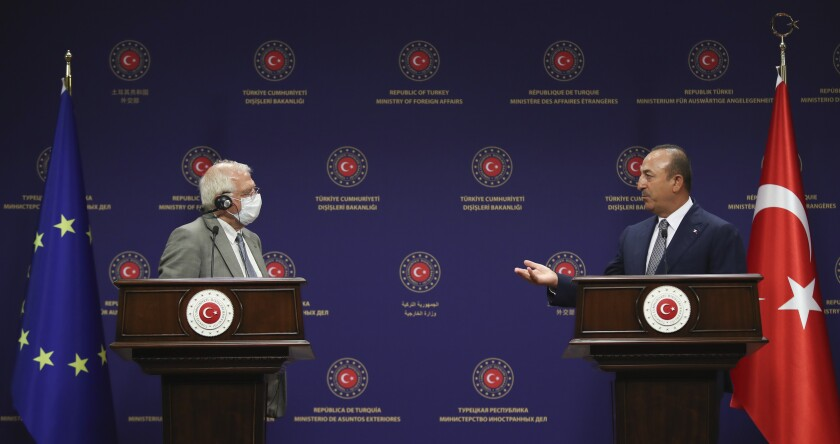 "Turkey's Foreign Minister Mevlut Cavusoglu, right, and Josep Borrell Fontelles, High Representative and Vice-President of the European Commission, speak during a joint news conference, in Ankara, Turkey, Monday, July 6, 2020. Turkey's Foreign Minister on Monday called on the European Union to be an ""honest broker"" in disputes between Turkey and EU member states France, Greece and Cyprus, warning that his country would be forced to ""reciprocate"" against any decisions the bloc takes against Ankara.(Cem Ozdel/Turkish Foreign Ministry via AP, Pool)"